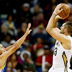 Nov 26, 2013; New Orleans, LA, USA; New Orleans Pelicans power forward Ryan Anderson (33) shoots over Golden State Warriors point guard Stephen Curry (30) during the second half of a game at New Orleans Arena. The Warriors defeated the Pelicans 102-101. Mandatory Credit: Derick E. Hingle-USA TODAY Sports