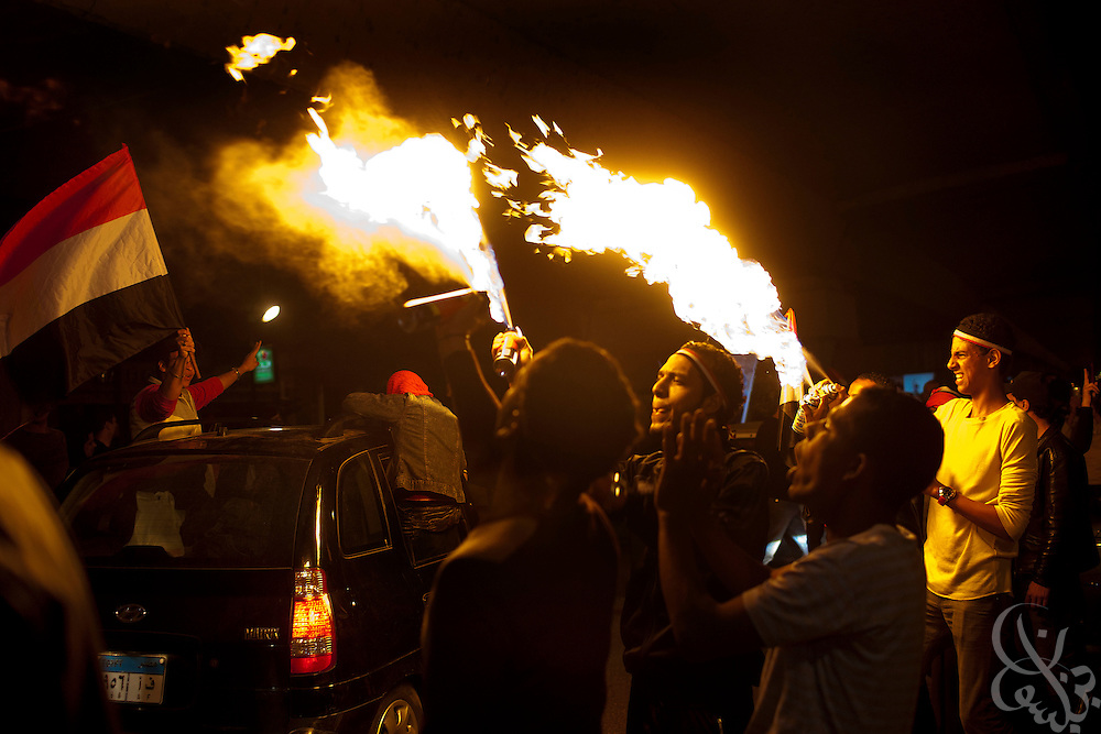 Egyptian youths celebrate the news that Egyptian President Hosni Mubarak had stepped down by burning aerosols and waving flags February 11, 2011 in the Zamalek District of Cairo, Egypt. (Photo by Scott Nelson)