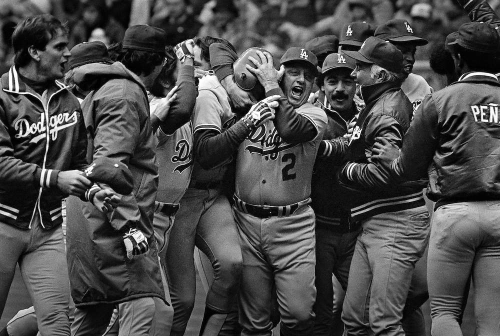 Los Angeles Dodgers Manager Tom Lasorda  embraces Rick Monday after he hit a home run against the Montreal Expos to win the National League Championship Montreal, Que. (1981)