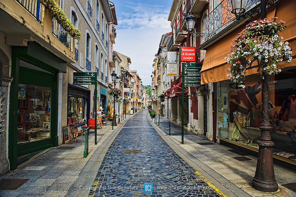 One of the quaint streets in Lourdes France...Lourdes is a small market town lying in the foothills of the Pyrenees, famous for the Marian apparitions of Our Lady of Lourdes that are reported to have occurred in 1858 to Bernadette Soubirous.