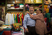Purushottam Goyal, left, and Saroj Goyal at the Dress Shoppe II, an Indian textiles store in East Village. The pair have been married for 46 years. They've been running the shop for 38 years.