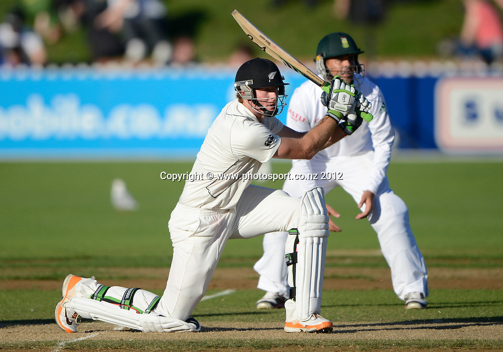 New Zealand opening batsman Martin Guptill hits out as Jacques Rudolph looks on. Third Test, Day 3. New Zealand Black Caps versus South Africa Proteas, Basin Reserve, Wellington, New Zealand. Sunday 25 March 2012. Photo: Andrew Cornaga/Photosport.co.nz
