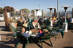 People at restaurant Half Moon Bay Brewing in Princeton, .San Mateo Coast of California, south of San Francisco.  Photo copyright Lee Foster, 510-549-2202, lee@fostertravel.com, www.fostertravel.com.  Photo 435-31212