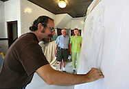 Tom Torluemke (from left) works on a sketch of Dennis Beatty and Jackie Soukup of Cedar Rapids at the Firehouse Studio next to CSPS Hall, 1103 Third St SE in Cedar Rapids on Saturday afternoon, June 2, 2012. Torluemke will be drawing portraits through Monday and the painting will be unveiled at a June 8th reception at CSPS Hall. (Stephen Mally/Freelance)