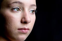 Teenaged girl looking thoughtful,