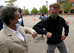 Actor Sean Penn and Mayor Lori Lightfoot greet each other with an elbow bump upon their arrival at the city's COVID-19 testing site in the parking lot of Dr. Jorge Prieto Math and Science Academy in Chicago, IL, USA, Monday, May 18, 2020. Photo by Antonio Perez/Chicago Tribune/TNS/ABACAPRESS.COM
