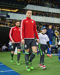 KIEV, UKRAINE - Easter Monday, March 28, 2016: Wales' James Chester walks out before the International Friendly match against Ukraine at the NSK Olimpiyskyi Stadium. (Pic by David Rawcliffe/Propaganda)