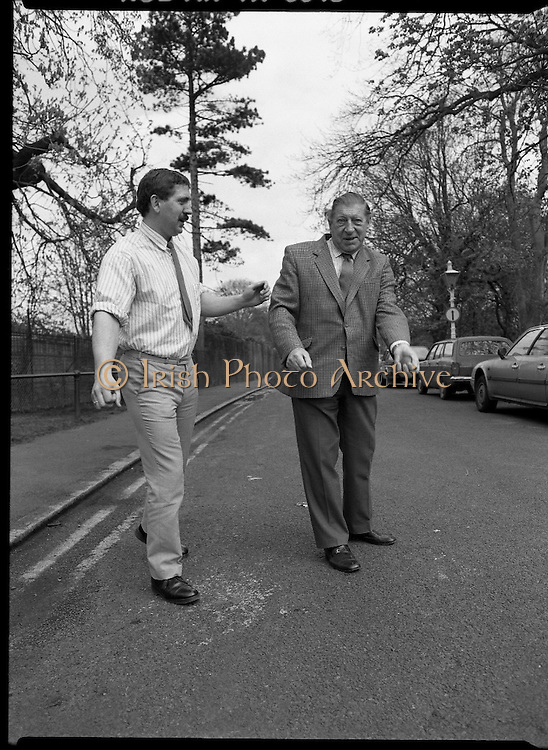 """First Dublin Road Bowling Tournament. (R99)..1989..03.04.1989..04.03.1989..3rd April 1989..The first Dublin road bowling tournament, sponsored by AIB and run by Bol Chumann Na hÉireann, in aid of Cerebral Palsy Ireland. It will take place in the Phoenix Park on Sunday 14th May 1989. This was announced at a reception in the Phoenix Park..The rout of the tournament will be from Mountjoy Crossing through The Whitefields Road to the Phoenix Monument and back the Straight Road to the finishing line at mountjoy Crossing, a distance of two miles..Armagh and Cork will challenge each other for a new Perpetual Trophy """"Super Bol""""...Image shows World Champion bowler,Bill Daly, Cork,teaching Mr Norman Cairns, Chairman, Cerebral Palsy Ireland, some of the skills necessary to take part in road bowling."""