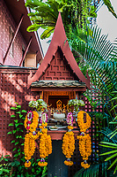 small altar and flower offerings at Jim Thompson house in Bangkok Thailand