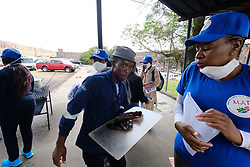 ALEXANDRA SOUTH AFRICA - APRIL 25: Health workers enter a hostel to engage with community members. During intensified testing and screening on Freedom Day, screening and testing includes people over over 60, flu-like symptoms, comorbid conditions, like diabetes, asthma, hypertencsion, HIV and tuberculosis on April 25, 2020 in Alexandra South Africa. Under pressure from a global pandemic. President Ramaphosa declared a 21 day national lockdown extended by another two weeks, mobilising goverment structures accross the nation to combat the rapidly spreading COVID-19 virus - the lockdown requires businesses to close and the public to stay at home during this period, unless part of approved essential services. (Photo by Dino Lloyd)