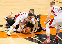 Players dive on the floor after a loose ball during a semi-final game at the Charleston Civic Center.