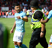 Sergio Aguero (10) of Manchester City walks away after confronting a police officer who was keeping him away from the celebrating crowd after Raheem Sterling (7) of Manchester City winning goalduring the Premier League match between Bournemouth and Manchester City at the Vitality Stadium, Bournemouth, England on 26 August 2017. Photo by Graham Hunt.