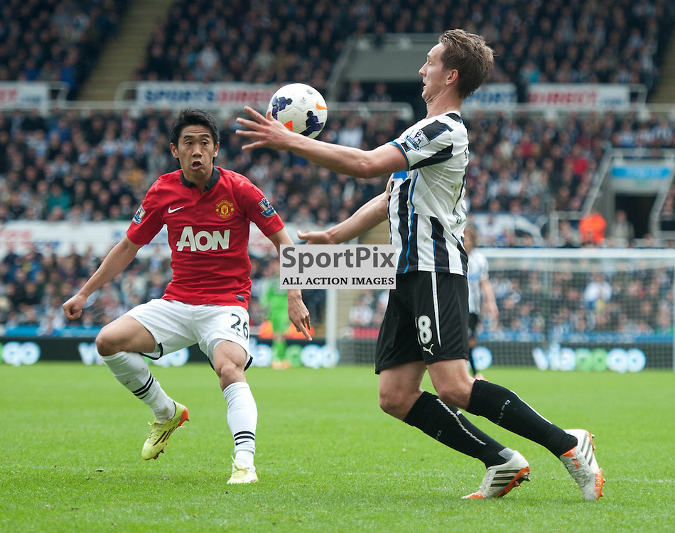 Luuk de Jong and Shinji Kagawa in action. Newcastle United v Manchester United, PREM, St James Park, Saturday 5 April 2014 (c) ANGIE ISAC | SportPix.eu