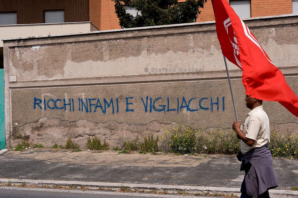 Roma, 25 Aprile 2015<br /> Manifestazione meticcia, antifascista, e contro il razzismo al quartiere  Tor Sapienza per il  giorno del  70esimo anniversario della Liberazione dal nazi-fascismo. Nella foto: Sul muro si legge: Ricchi infami e vigliacchi.<br /> Rome, April 25, 2015<br /> Demostration antifascist, and  against racism to the neighborhood Tor Sapienza for the day of the 70th anniversary of the liberation from Nazi-Fascism. n the picture: On the wall reads: Rich infamous and cowards.