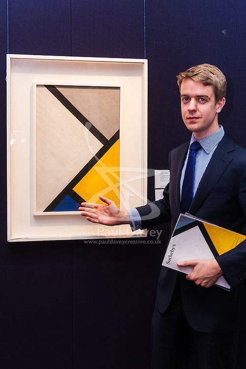 "London, November 7th 2014. Sotheby's is to hold its Inaugural 20TH Century Art– A Different Perspective sale on November 12th in London, where collectors will have the opportunity to acquire some highly regarded examples of avante-garde and abstract art. PICTURED: Richard Lowkes, a Sotheby's paintings specialist discusses Cesar Domela's ""Composition Neo-plastique from 1926 which is estimated will fetch between £400,000 to £600,000."