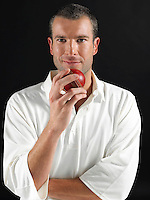 Man holding cricket ball portrait