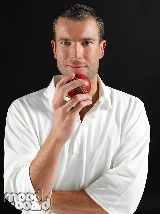 Man holding cricket ball portrait