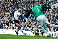 Photo: Ed Godden.<br />Tottenham Hotspur v Manchester City. The Barclays Premiership. 08/04/2006. Spurs' Aaron Lennon takes the ball round the Man City keeper, David James.