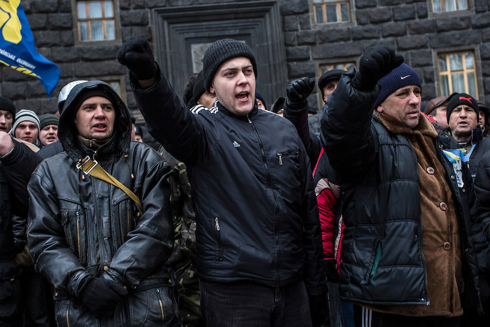 KIEV, UKRAINE - DECEMBER 5: Anti-government protesters rally in front of the Cabinet of Ministers building on December 5, 2013 in Kiev, Ukraine. Thousands of people have been protesting against the government since a decision by Ukrainian president Viktor Yanukovych to suspend a trade and partnership agreement with the European Union in favor of incentives from Russia. (Photo by Brendan Hoffman/Getty Images) *** Local Caption ***