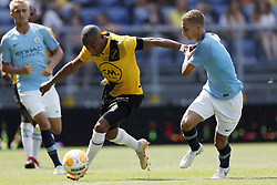 (L-R) Mikhail Rosheuvel of NAC Breda, Tyreke Wilson of EDS Team Manchester City during the Pre-season Friendly match between NAC Breda and EDS Team Manchester City at Rat Verlegh stadium on August 04, 2018 in Breda, The Netherlands