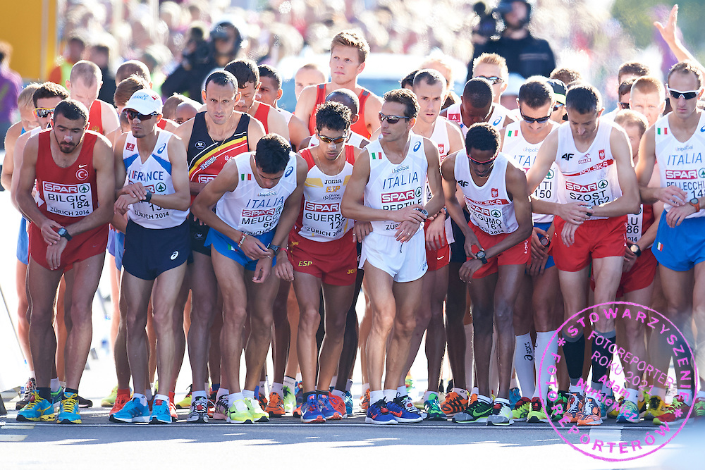 (3R) Yared Shegumo and (2R) Henryk Szost both from Poland competes in men's marathon on the start line during the Sixth Day of the European Athletics Championships Zurich 2014 at Letzigrund Stadium in Zurich, Switzerland.<br /> <br /> Switzerland, Zurich, August 17, 2014<br /> <br /> Picture also available in RAW (NEF) or TIFF format on special request.<br /> <br /> For editorial use only. Any commercial or promotional use requires permission.<br /> <br /> Photo by &copy; Adam Nurkiewicz / Mediasport