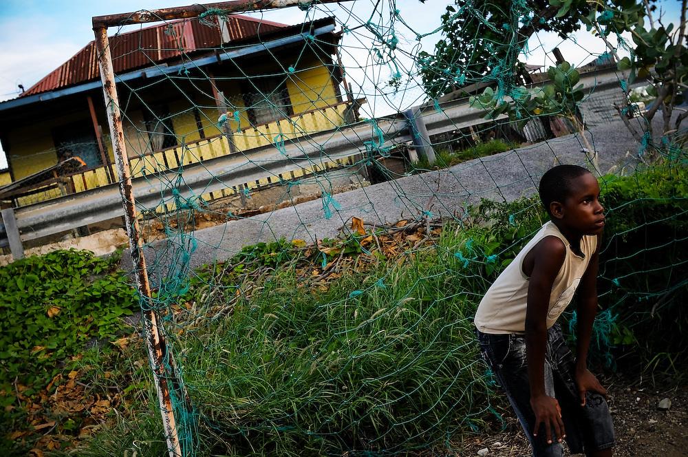 A boy plays soccer in Paraiso, a slum in Willemstad, Curaçao.