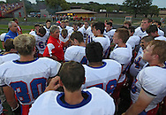 Decorah head coach Bill Post talks to his team before the start of the game between the Decorah Vikings and the Marion Indians at Thomas Park in Marion on Friday, August 31, 2012.