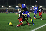 AFC Wimbledon striker Dominic Poleon (10) and Coventry City defender Dion Kelly-Evans (30) during the EFL Sky Bet League 1 match between AFC Wimbledon and Coventry City at the Cherry Red Records Stadium, Kingston, England on 14 February 2017. Photo by Stuart Butcher.