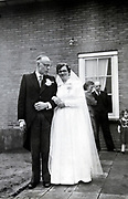 casual portrait of newly wed couple 1960s