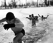 "19/12/2009.Members of the ""Otwocki Club Morsa Hipotermia"" bath in the icy waters of the Lacha Lake in Otwock, 20km south of Warsaw, Poland. People who bath in icy waters are known as ""Morsy"", the walruses."
