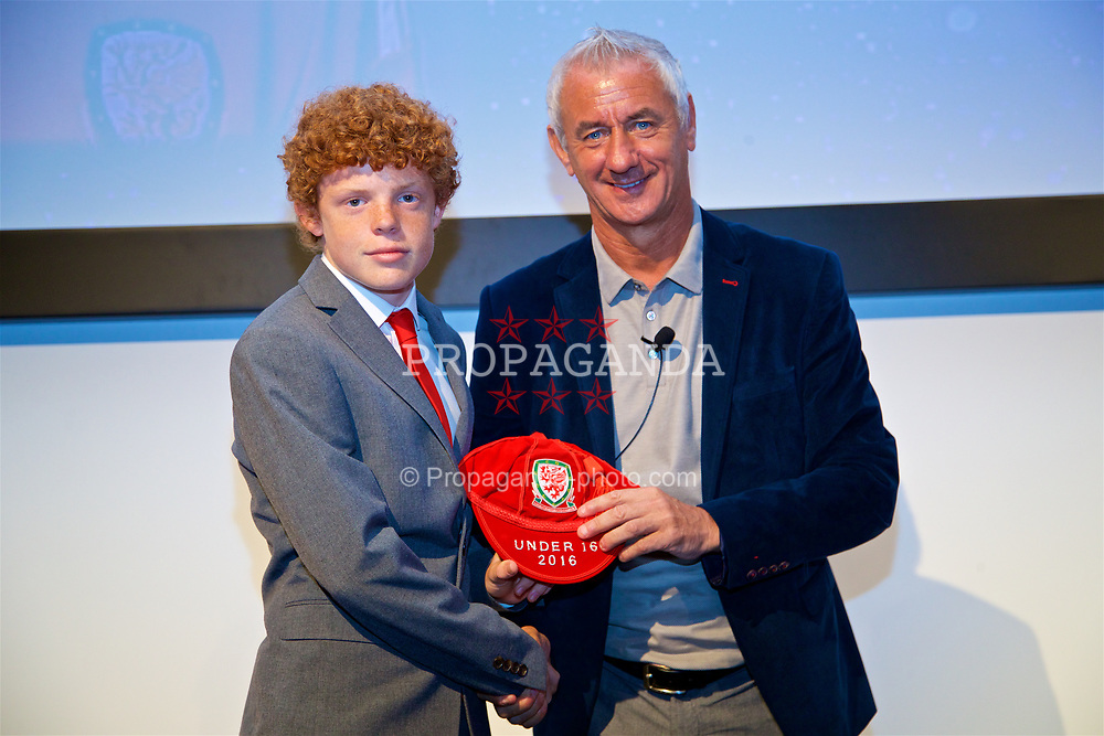 NEWPORT, WALES - Saturday, May 27, 2017: Lewis Clutton receives his Under-16 Wales cap from Wales' Elite Performance Director Ian Rush at the Celtic Manor Resort. (Pic by David Rawcliffe/Propaganda)