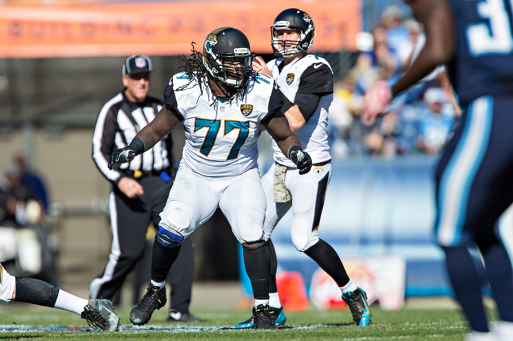 NASHVILLE, TN - NOVEMBER 10:  Uche Nwaneri #77 of the Jacksonville Jaguars blocks during a play against the Tennessee Titans at LP Field on November 10, 2013 in Nashville, Tennessee.  The Jaguars defeated the Titans 29-27.  (Photo by Wesley Hitt/Getty Images) *** Local Caption *** Uche Nwaneri
