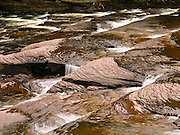"One of several beautiful falls tumble over ""Nonesuch Shale"" rock on the Presque Isle River in Porcupine Mountains Wilderness State Park, Michigan, USA."