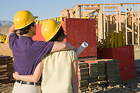Couple in construction site