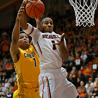 Oregon State's Gary Payton II, center, grabs a rebound away from California's Ivan Rabb, left, in the second half of an NCAA college basketball game in Corvallis, Ore., on Saturday, Jan. 9, 2016. Oregon State won 77-71. (AP Photo/Timothy J. Gonzalez)