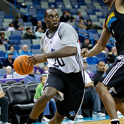 December 17, 2011; New Orleans, LA, USA; New Orleans Hornets white team small forward Quincy Pondexter (20) drives past New Orleans Hornets black team small forward Trevor Ariza (1) during a scrimmage at the New Orleans Arena.   Mandatory Credit: Derick E. Hingle-US PRESSWIRE