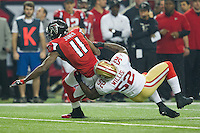 20 January 2013: Wide receiver (11) Julio Jones of the Atlanta Falcons catches a pass and is tackled by (52) Patrick Willis of the San Francisco 49ers during the first half of the 49ers 28-24 victory over the Falcons in the NFC Championship Game at the Georgia Dome in Atlanta, GA.