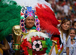 MOSCOW, RUSSIA - Sunday, June 17, 2018: A Mexico supporter with a feather headdress and a World Cup trophy during the FIFA World Cup Russia 2018 Group F match between Germany and Mexico at the Luzhniki Stadium. (Pic by David Rawcliffe/Propaganda)