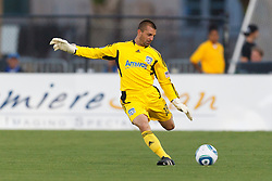 July 20, 2011; Santa Clara, CA, USA;  San Jose Earthquakes goalkeeper Jon Busch (18) kicks the ball against the Vancouver Whitecaps during the first half at Buck Shaw Stadium.