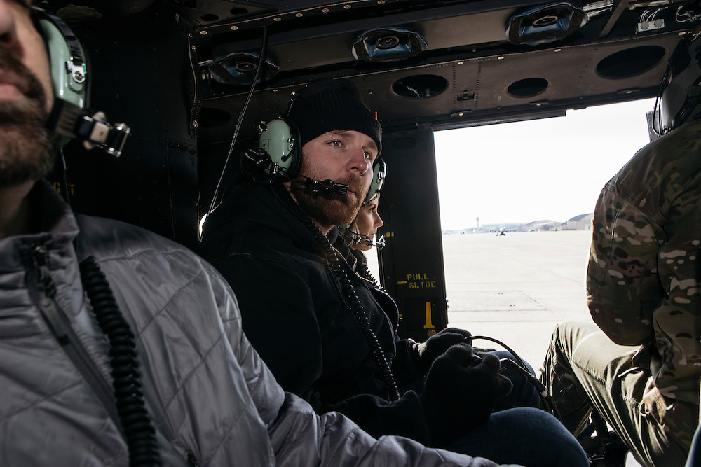 Prince George's County, MD - December  13, 2016:  WWE Superstars Dean Ambrose, center, and Renee Lynch, prepare for a helicopter tour in a UH-1N Huey around Washington, D.C. during Tribute to the Troops Day at the Joint Base Andrews in Prince George's County, Maryland.  WWE Superstars will spend time with members of all five branches of the military.  WWE began Tribute to the Troops in 2003 as a way to honor our servicemen and women and their families.   (Greg Kahn for ESPN)