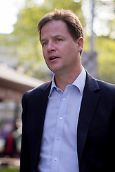 © licensed to London News Pictures. London, UK 07/03/2013. Deputy Prime Minister Nick Clegg (centre) arriving LBC Radio Studios in Leicester Square, London on Thursday, 16 May 2013. Photo credit: Tolga Akmen/LNP