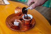 Elvis pouring a coup of traditional Bosnian coffee which is a part of the Bosnian and Herzegovinian identity at a resting place at Igman mountain. It is the symbol of the country and a part of its tradition.
