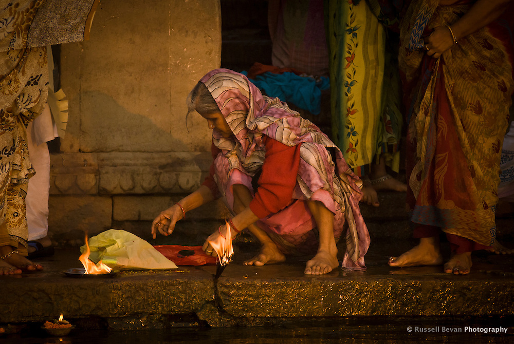 An old woman prepares her offering during the festival of Kartik Poornima in Varanasi, Uttar Pradesh, India