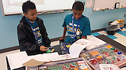 Students learn how to build computers, connect to a Wi-Fi network, and work with computer programming software at a free computer camp sponsored by Schlumberger and KidsXplore at Lockhart ES.