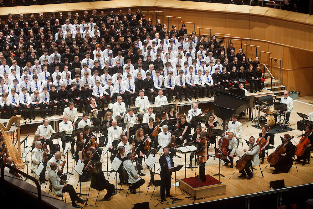 Over 650 singers from nine NYCoS Area Choirs throughout Scotland with the black shirts of the Changed Voice section of NYCoS National Boys Choir, conducted by Christopher Bell (pictured right) and joined by the Orchestra of Scottish Opera perform Tom Cunningham's specially commissioned 'Seven Planets and a Cosmic Rock ' at The Royal Concert Hall.  Actor Billy Boyd (pictured left), patron of the National Boys Choir, narrated this section of the show.<br /> Glasgow. Sunday 8th May 2011<br /> Picture Drew Farrell<br /> Tel : 07721-735041.<br /> Note to Editors:  This image is free to be used editorially in the promotion of the NYCOS. Without prejudice ALL other licences without prior consent will be deemed a breach of copyright under the 1988. Copyright Design and Patents Act  and will be subject to payment or legal action, where appropriate. For further information please contact Vicky Tibbitt Marketing and Communications Manager 0141-287-2801.