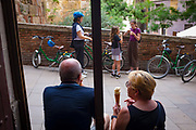 Couple eating organic ice cream at Swiit Ice Cream in Baixada de Viladecols, Barcelona.