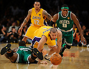 Jordan Farmar takes the ball away from Nate Robinson in the 4th quarter while Celtics Rajon Rondo is late for the party. The Lakers defeated the Boston Celtics in game 6 of the NBA Finals 89-67. Los Angeles, CA 06/15/2010 (John McCoy/Staff Photographer).