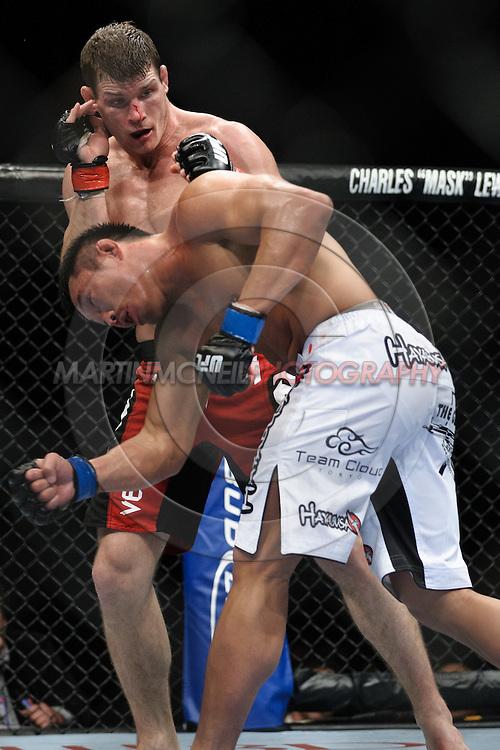 "LONDON, ENGLAND, OCTOBER 2010: Michael Bisping (facing) evades a looping punch from Yoshihiro Akiyama during ""UFC 120: Bisping vs. Akiyama"" inside the O2 Arena in Greenwich, London"