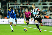 Javier Manquillo (#19) of Newcastle United advances on the ball pursued by Aaron Lennon (#12) of Everton during the Premier League match between Newcastle United and Everton at St. James's Park, Newcastle, England on 13 December 2017. Photo by Craig Doyle.