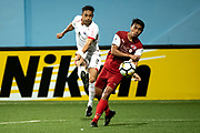 SINGAPORE,SINGAPORE - MAY 8: Addison Oliveira of Persija Jakarta (L) is challenged by Jumaat Jantan of Home United (R)  during the AFC Cup Zonal Semi final between Home United and Persija Jakarta at Jalan Besar Stadium on May 8, 2018. (Photo by PictoBank/Getty Images)